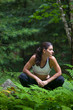 Woman Runner sitting in forrest