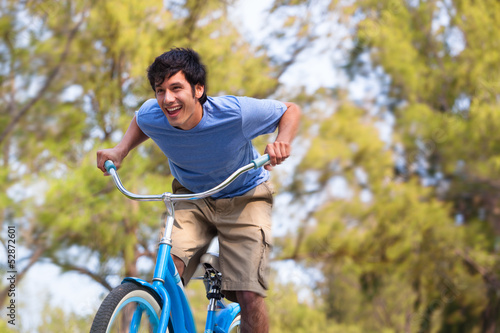 Young Man on bike wth trees
