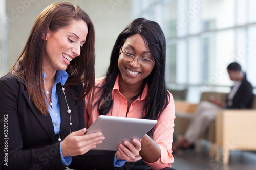 Two businesswomen in lobby