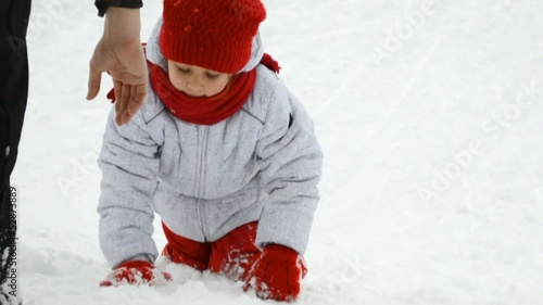 girl climbing up a snowy hill not taking a hand