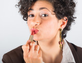 Young Businesswoman Applying Lipstick