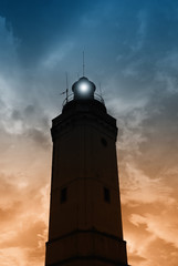 cloudy sky over the lighthouse in the evening