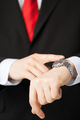 man looking at wristwatch