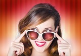 Face of a retro pinup girl in trendy sunglasses