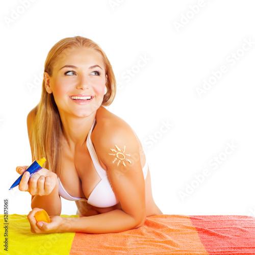 Pretty woman applying suncream