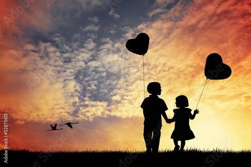 Children with balloons in the shape of heart