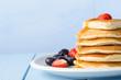 Stacked Pancakes and Fruit with Maple Syrup