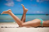 Women's beautiful legs on the beach - Fine Art prints