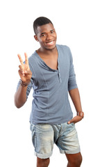 Peace gesture, smiling young man