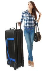 Teen girl with a big, black travel bag on wheels.