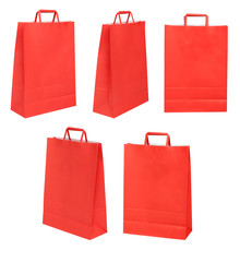 Group of red papers bags on different possitions