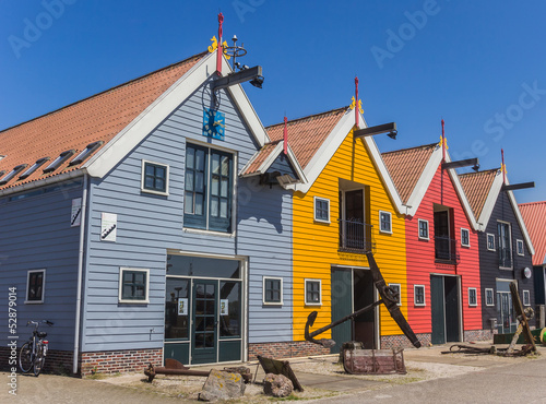 Colorful houses at the harbor of Zoutkamp
