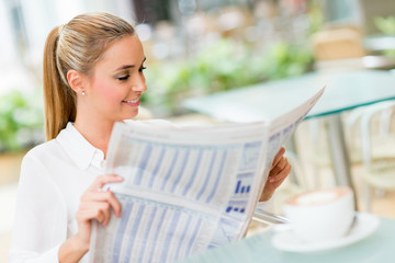 Business woman reading news