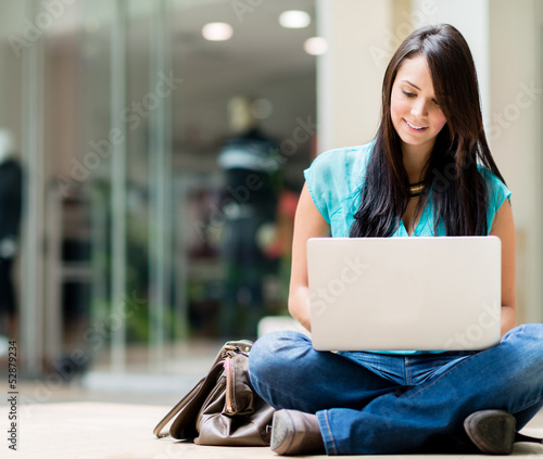 Casual woman working online