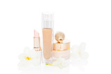 Beige feminine make up and cosmetic products.