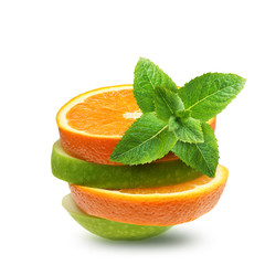 Apples and orange fruit with green mint leaves  isolated