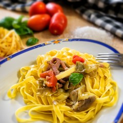 Fettuccine with artichokes and cherry tomatoes