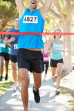 Male Runner Winning Marathon