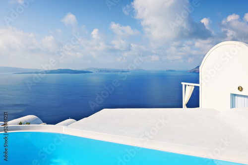 Swimming pool overlooking the caldera in Oia