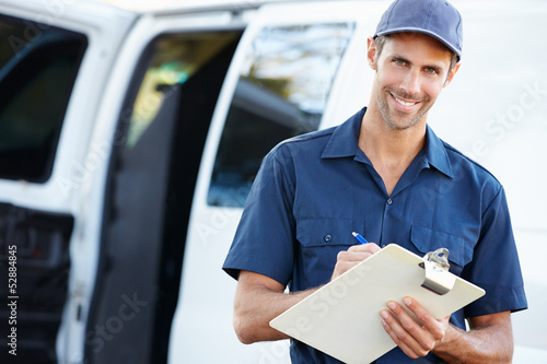 Portrait Of Delivery Driver With Clipboard - 52884845