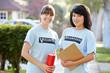 Portrait Of Two Female Charity Volunteers On Street