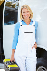 Portrait Of Female Repair Person With Van