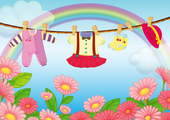 Baby clothes hanging in the garden