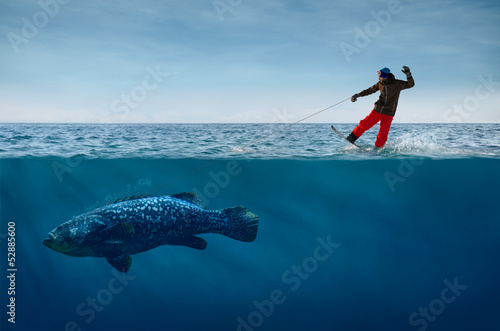 Snowboarder Surfing on Waves with the Fish on a Leash