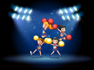 A stage with a cheerleading squad