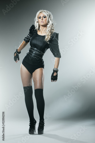 Young blonde in attractive high fashion black clothes