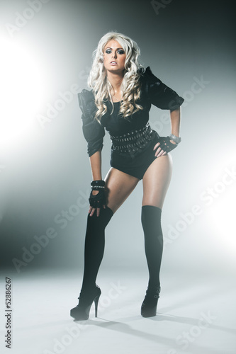 Blonde in attractive high fashion black clothes with stockings
