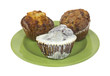 Fresh muffins on green plate