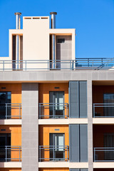 New Resort Apartment House against bright blue sky