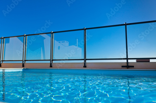 Leinwandbild Motiv Outdoor swimming pool at the House roof