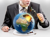 Greedy businessman eating planet Earth