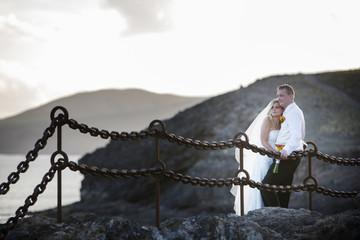 Newlyweds on the volcanic landscape background.
