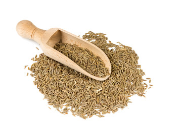 Cumin seeds in a spoon for spices