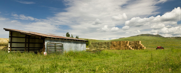 hay bales and large shed