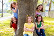 Children group of sisters girls and friends on tree trunk