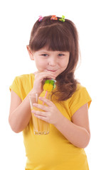 Beautiful little girl drinking orange juice