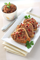 Liver pate with paprika on slices of wholegrain bread