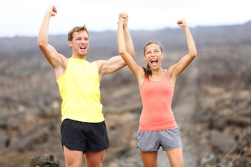 Cheering celebrating happy fitness runner couple