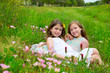 children friends girls on spring poppy flowers meadow
