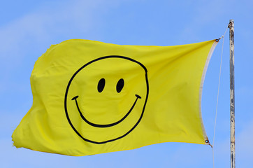 Yellow flag with smiley face