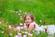 children cute girl on spring meadow with poppy flowers
