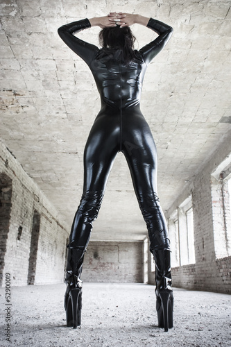 Sexy fetish model posing in old industrial building