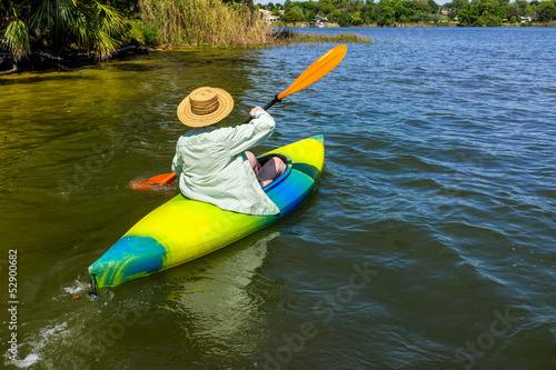 Woman Enjoys Quality Time in Her Kayak