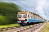 Fototapety Suburban electric train on a blurred background