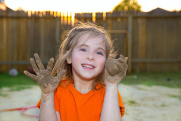 children girl playing with mud sand ball and dirty hands