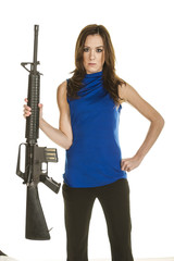 Attractive young woman with assault rifle